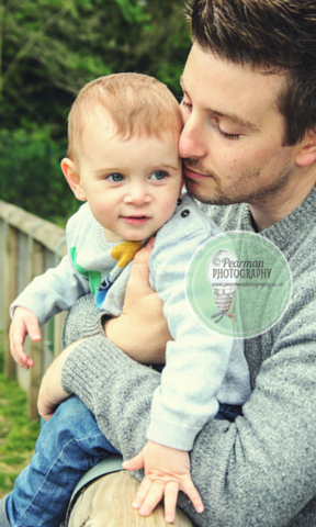 A Beautiful portrait of Daddy Pete and son Joshua, in an embrace.