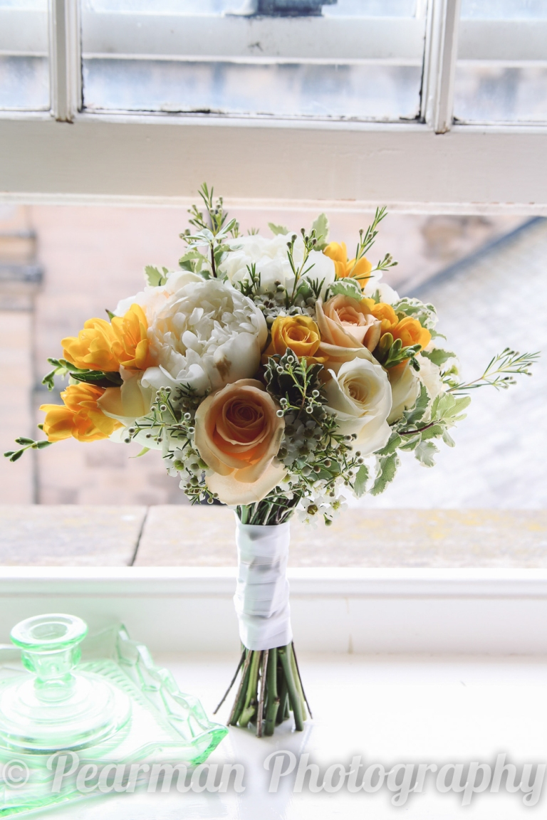 A Wedding bouquet standing upright in a sun filled window
