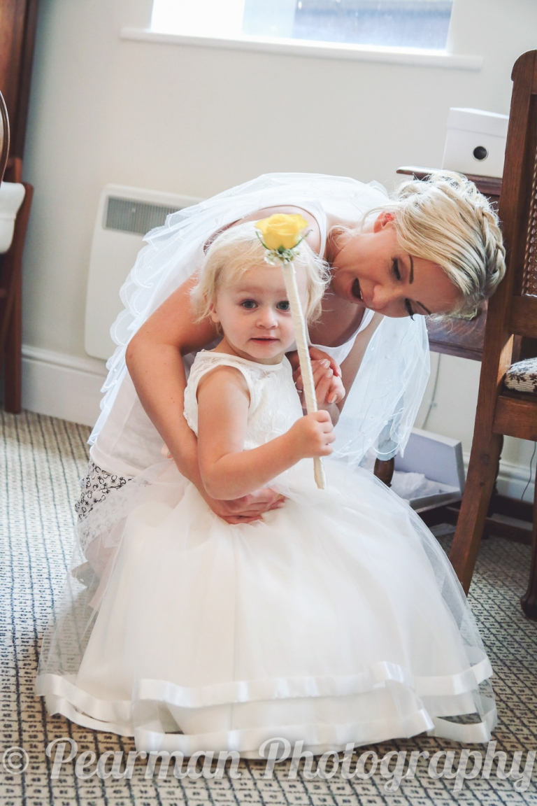 Bride and Flowergirl share a moment