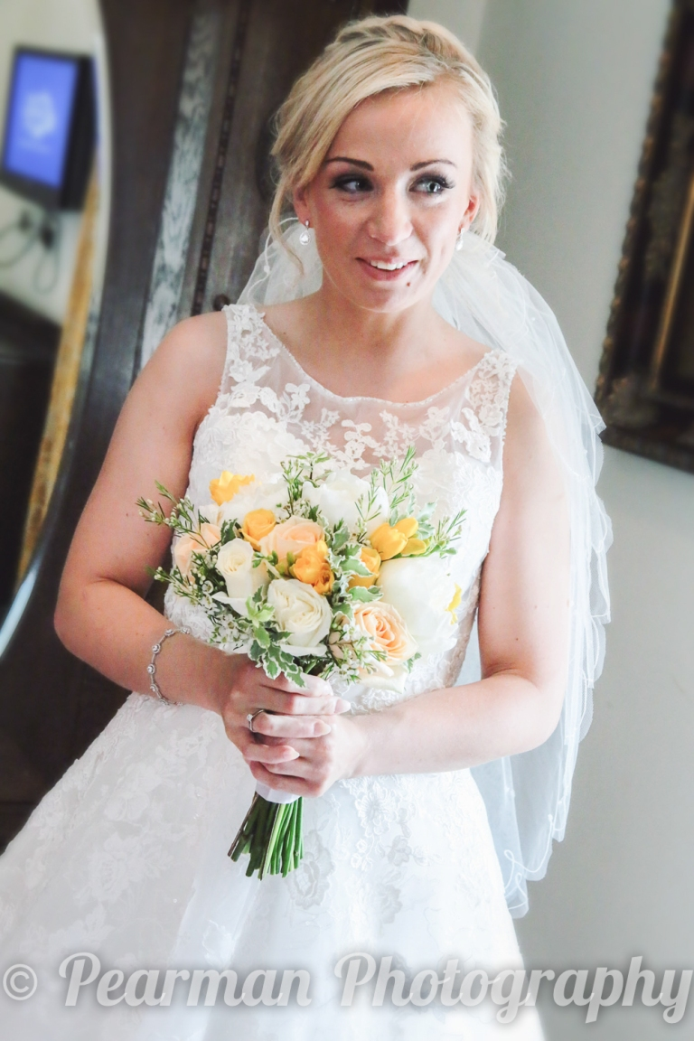 Bride Fully Dressed holding her Bouquet