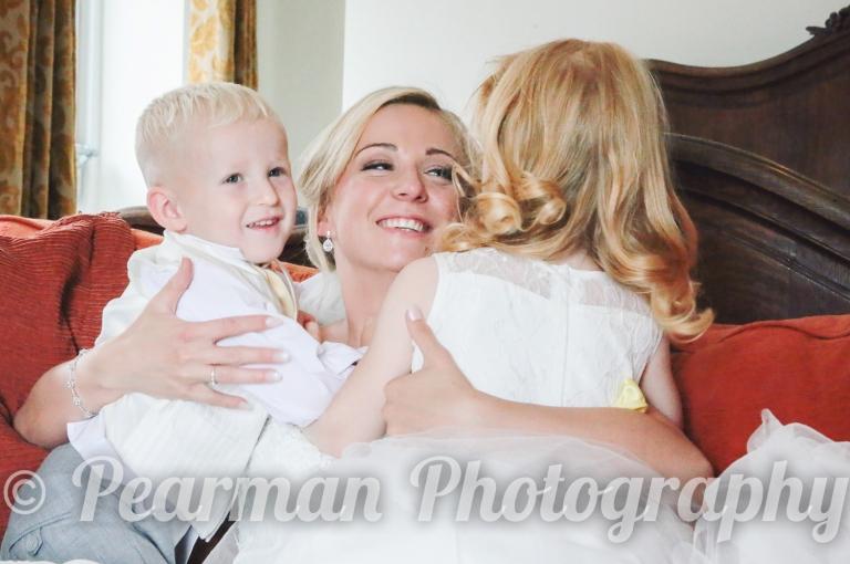 Bride hugging her children