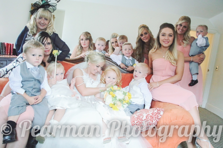 Brides and Her Maids, and all their children Ready at last posing for the camera