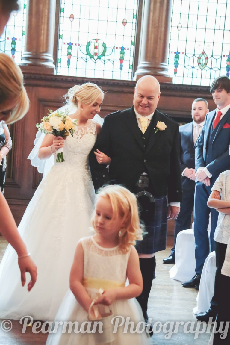 Laurel and her Dad shared a few whispers when walking up the aisle together