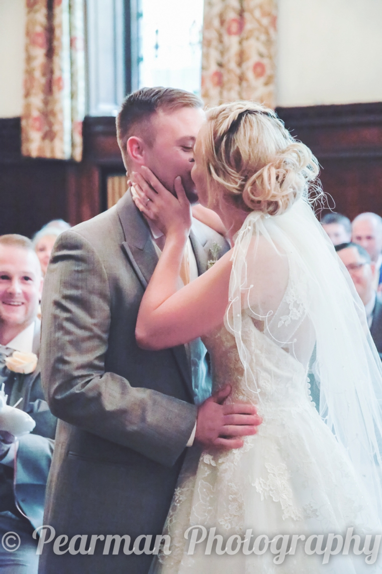 Bride and Groom kiss at the moment of being pronounced man and wife