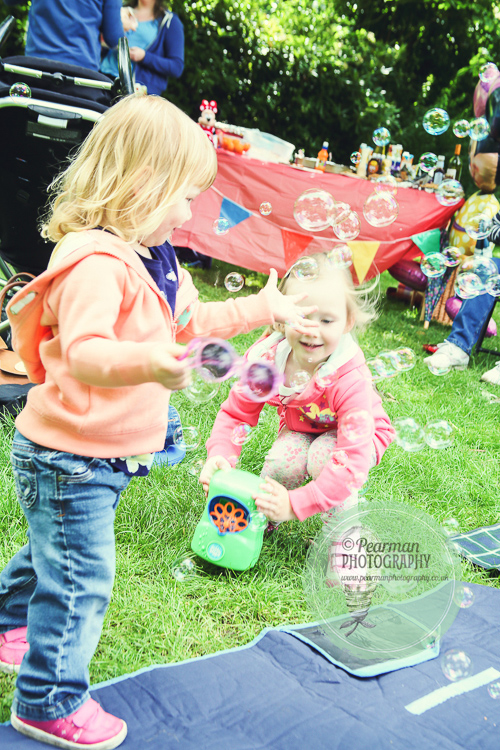 Children playing with Bubbles, filled with glee
