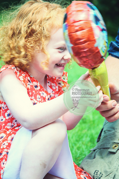 Little Girl Laughing at a party goodie bag