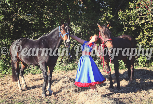 Trish and her two horses by either side. Their lead ropes coordinate with her red and blue swing dress esemble